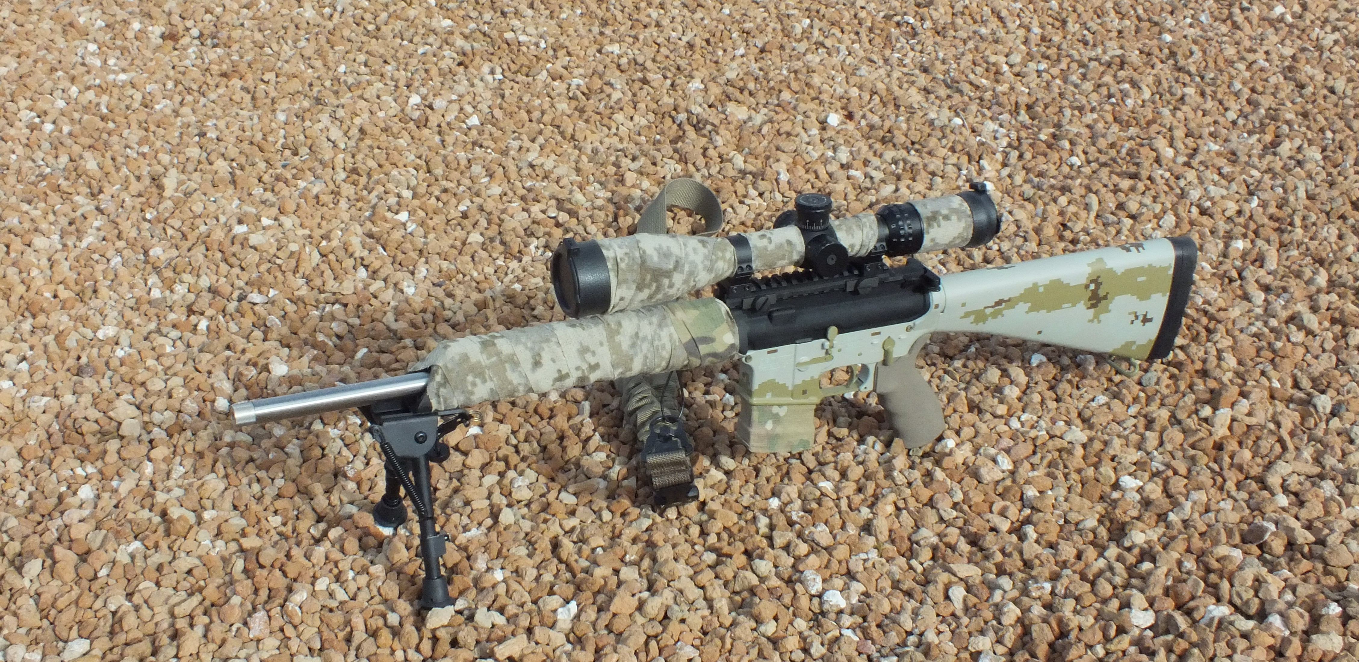 Black 25 45 with McNett Tape over forend and scope c09e564d7